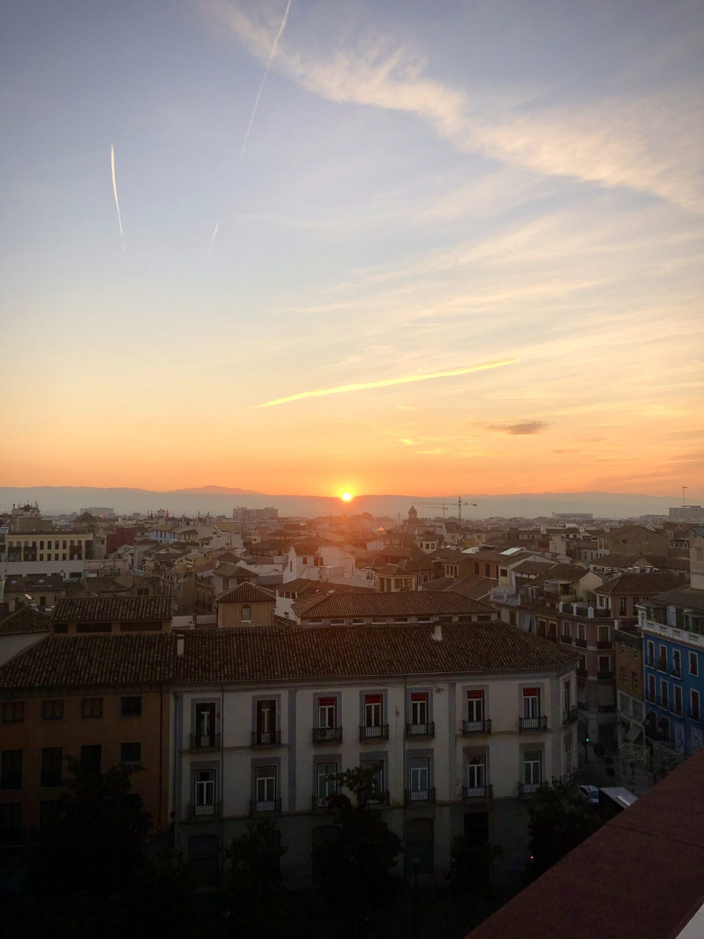 Sun set from Gran Via Coworking terrace in Granada