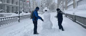 Snowman wearing a face mask in Madrid