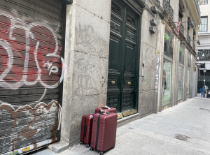 Luggage outside a doorway in Madrid
